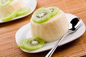 stock photo of panna  - Close up photograph of a sweet panna cotta with kiwifruit - JPG