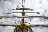 foto of sail ship  - Pirate sailboat mast with furled sails - JPG