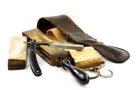 stock photo of barber razor  - sharpening leathers - JPG