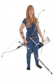 image of longbow  - Young girl with blue shirt and jeans standing with a longbow - JPG