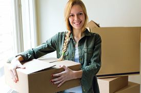 picture of independent woman  - Portrait of young beautiful woman moving in a new home - JPG