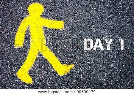 Yellow Pedestrian Figure Walking Towards Day One