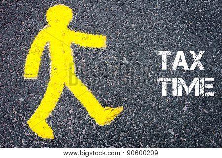 Yellow Pedestrian Figure Walking Towards Tax Time