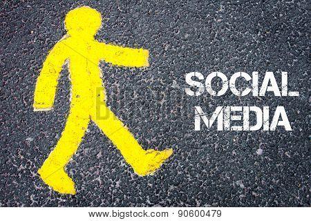 Pedestrian Figure Walking Towards Social Media