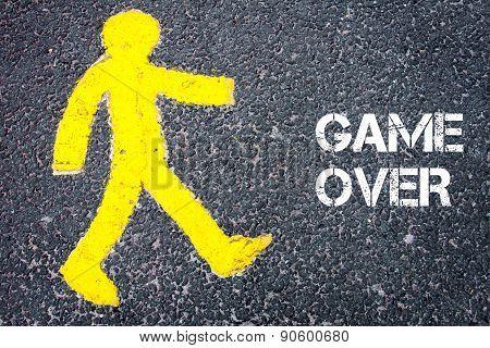 Yellow Pedestrian Figure Walking Towards Game Over