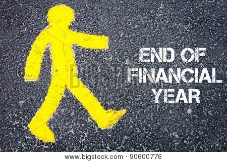 Pedestrian Figure Walking Towards End Of Financial Year