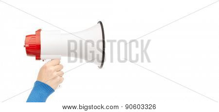 business, people and public announcement concept - closeup of female hand with megaphone