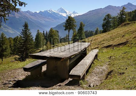 Empty Rustic Picnic Table And Benches On A Slope In The Mountains, Alps.