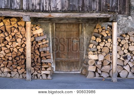 Fire Wood Stacked Outside Barn Door