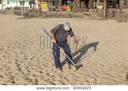 Government Man Cleans The Beach
