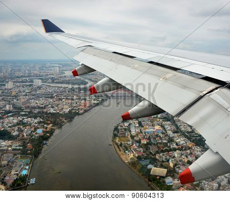 Aerial View Of Plane Coming Into Land Over Ho Chi Minh City.