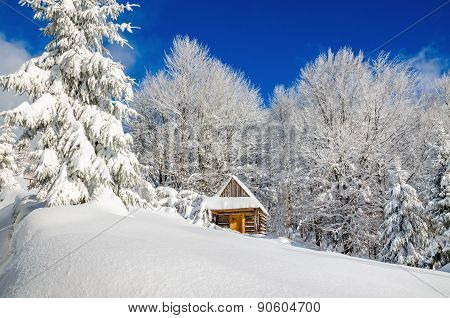 Mountain hut in winter landscape