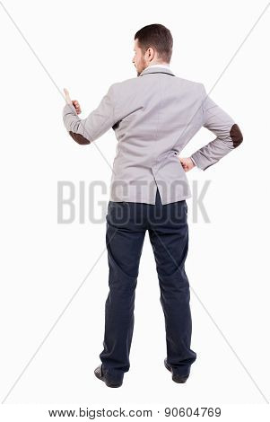 Back view of  business man shows thumbs up.   Rear view people collection. cheerful office worker shows positive emotions.  backside view of person. bearded man showing a sign of success.
