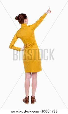 back view of woman. Young woman in vest presses down on something. Isolated over white background. Rear view people collection. backside view of person. . Beautiful slim girl in a strict dress.