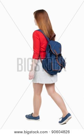 back view of walking  woman in dress with backpack.  girl in motion. backside view of person.  Rear view people collection. Isolated over white background.