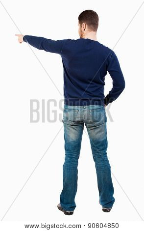 Back view of  pointing young men in jeans. Young guy  gesture. Rear view people collection.  backside view of person.  Isolated over white background. A bearded man in a blue jacket pointing to right
