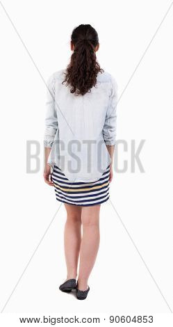 back view of walking  woman in jeans shirt. beautiful curly girl in motion.  backside view of person.  Rear view people collection. Isolated over white background.