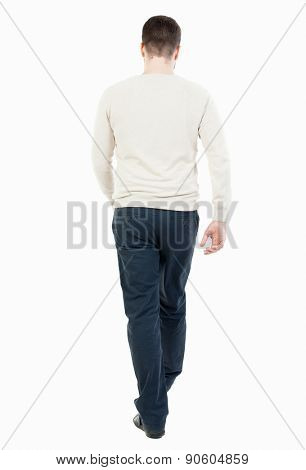 Back view going handsome man. walking young guy. Rear view people collection.  backside view person. Isolated over white background. guy in the demi-season jacket leaves. man in black trousers walks