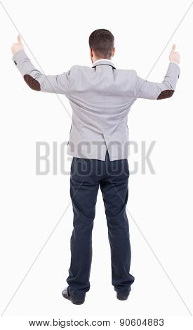 Back view of  business man shows thumbs up.   Rear view people collection. cheerful office worker shows positive emotions.  backside view of person.  Businessman with both hands showing signs success