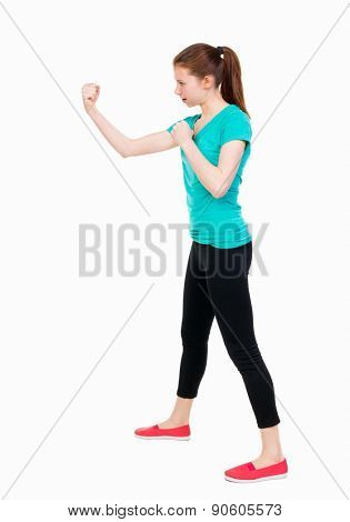 skinny woman funny fights waving his arms and legs. Isolated over white background. Girl in sportswear in sparring