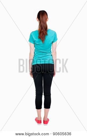 back view of standing young beautiful  woman. girl  watching. Rear view people collection.  backside view of person.  Isolated over white background. Girl in sports leggings.