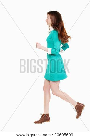 back view of running  woman. beautiful girl in motion. backside view of person.  Rear view people collection. Isolated over white background. smiling girl runs right