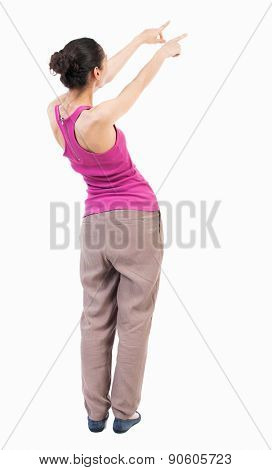 back view of woman. Young woman in vest presses down on something. Isolated over white background. Rear view people collection. backside view of person.  African-American hand points