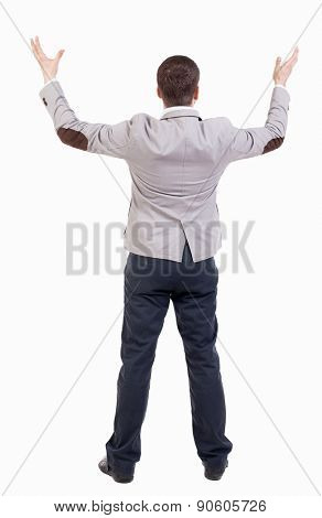 A man in a jacket raised his hands in prayer.   Standing young man. Rear view people collection.  backside view of person.  Isolated over white background.