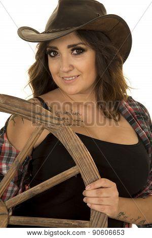 Cowgirl With Tattoo Wagon Wheel Looking