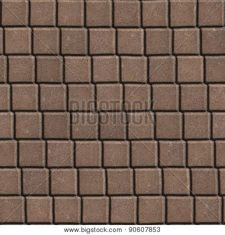 Brown Paving Slabs Laid out in Small Squares.