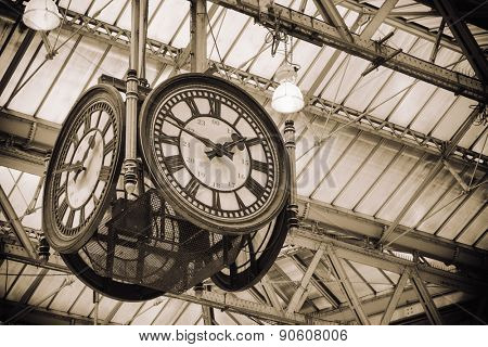 London, England, May 11th, 2015,  A large four-faced clock hangs in the middle of the main concourse.