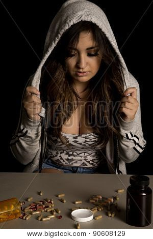 Woman With Tattoo With Drugs Hood Over Head