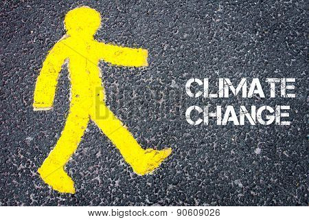 Yellow Pedestrian Figure Walking Towards Climate Change