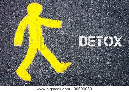 Yellow Pedestrian Figure Walking Towards Detox