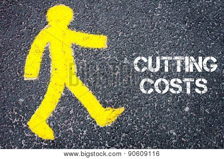 Yellow Pedestrian Figure Walking Towards Cutting Costs