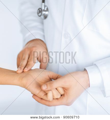 close up of doctor measuring patient heart beat