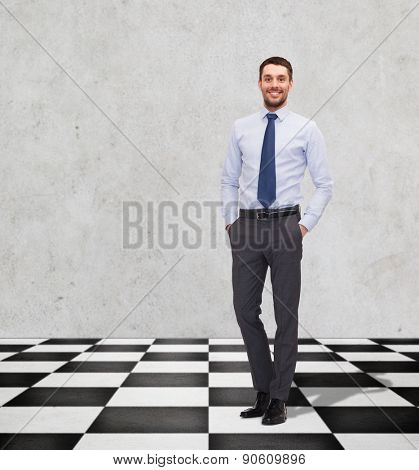 business, people and strategy concept - happy smiling businessman in shirt and tie on checkerboard pattern floor over gray background