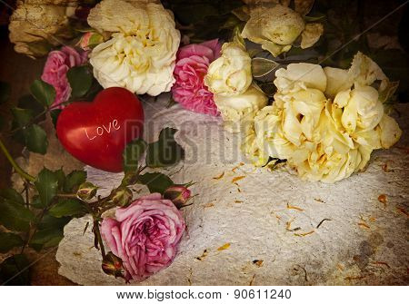 Beautiful flower background with roses, little red heart and handmade paper, Rose bouquet, wedding c