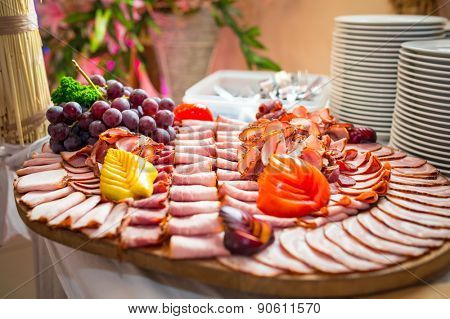 Choice of smoked ham and sausages on the table