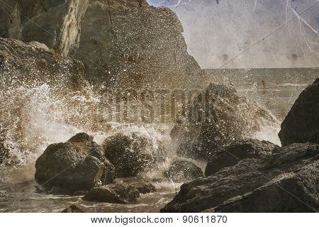 Beautiful water of the ocean and mountain background, summer beach, rocks on the ocean shore