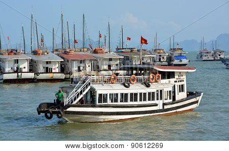 Small Tourist Boat Aarives In Halong Bay Marina.