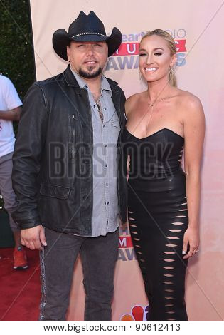 LOS ANGELES - MAR 29:  Jason Aldean & Brittany Kerr arrives to the 2015 iHeartRadio Music Awards  on March 29, 2015 in Hollywood, CA