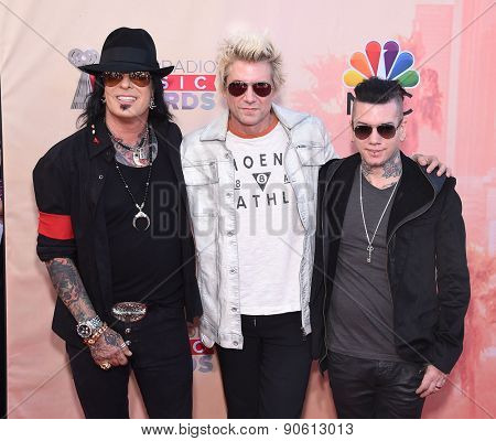 LOS ANGELES - MAR 29:  SIXX: A.M. arrives to the 2015 iHeartRadio Music Awards  on March 29, 2015 in Hollywood, CA