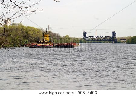 View of River Barge and Railroad Bridge