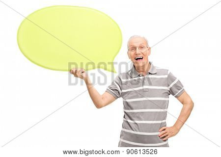 Excited senior man holding a big yellow speech bubble and looking at the camera isolated on white background