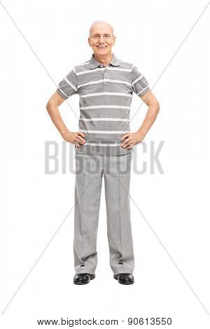 Full length portrait of a casual senior in gray pants and polo shirt, smiling and looking at the camera isolated on white background