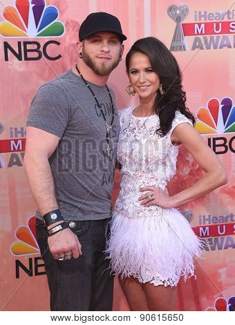 LOS ANGELES - MAR 29:  Brantley Gilbert & Amber Cochran arrives to the 2015 iHeartRadio Music Awards  on March 29, 2015 in Hollywood, CA