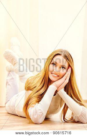 Beautiful smiling young woman enjoying staying at home.