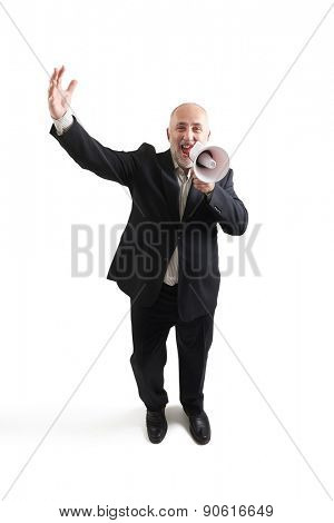 top view of joyous senior businessman with megaphone looking at camera and screaming. isolated on white background