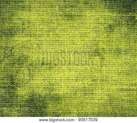 Grunge background of acid green burlap texture
